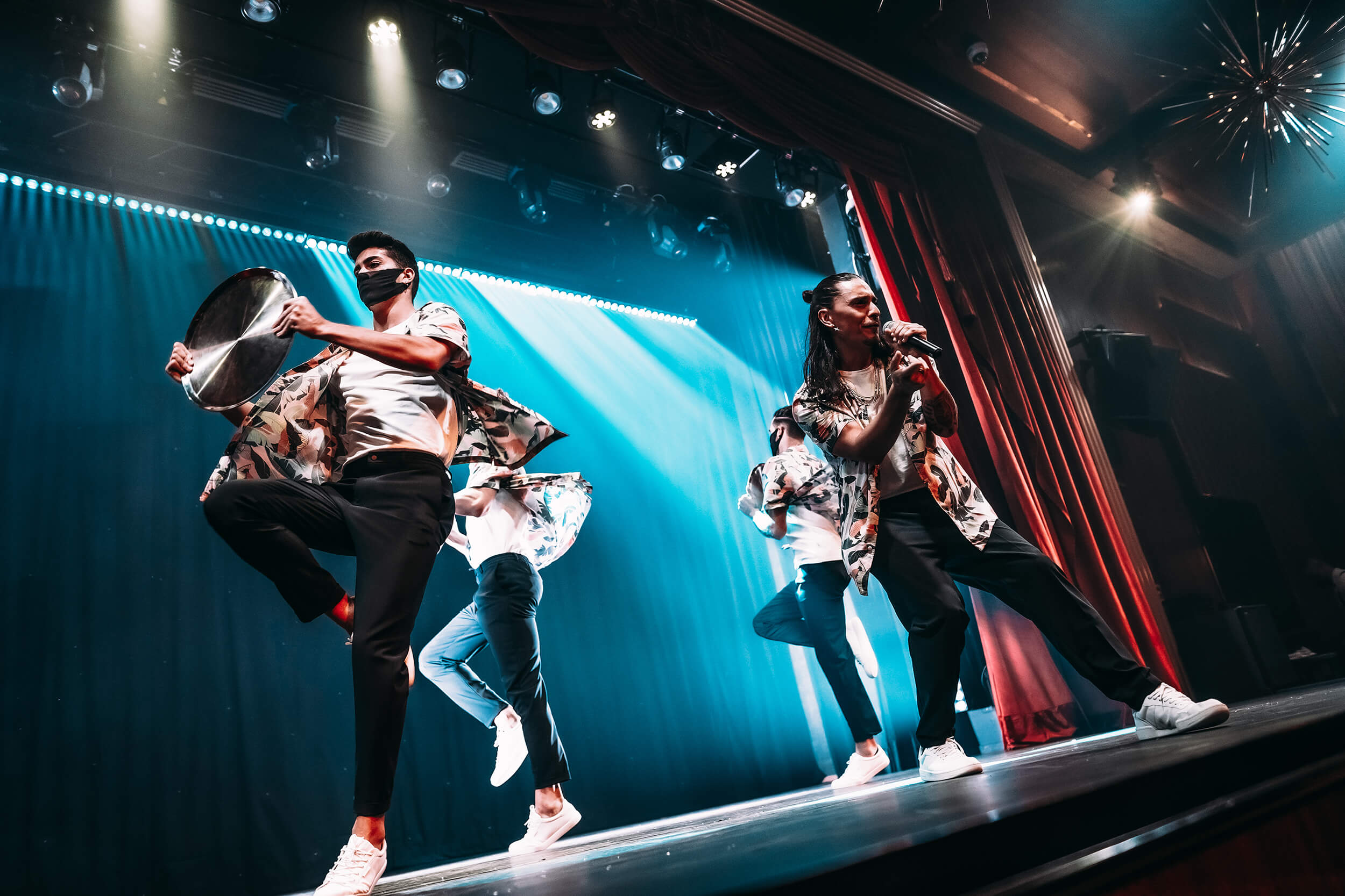 Performers dancing and singing