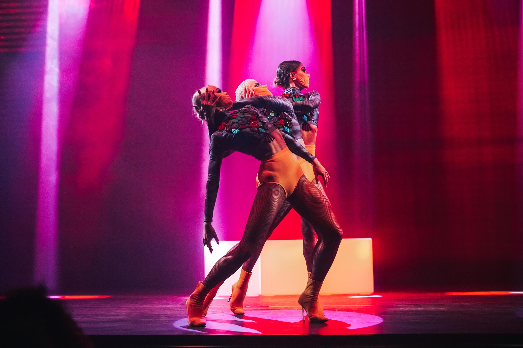 3 dancers performing